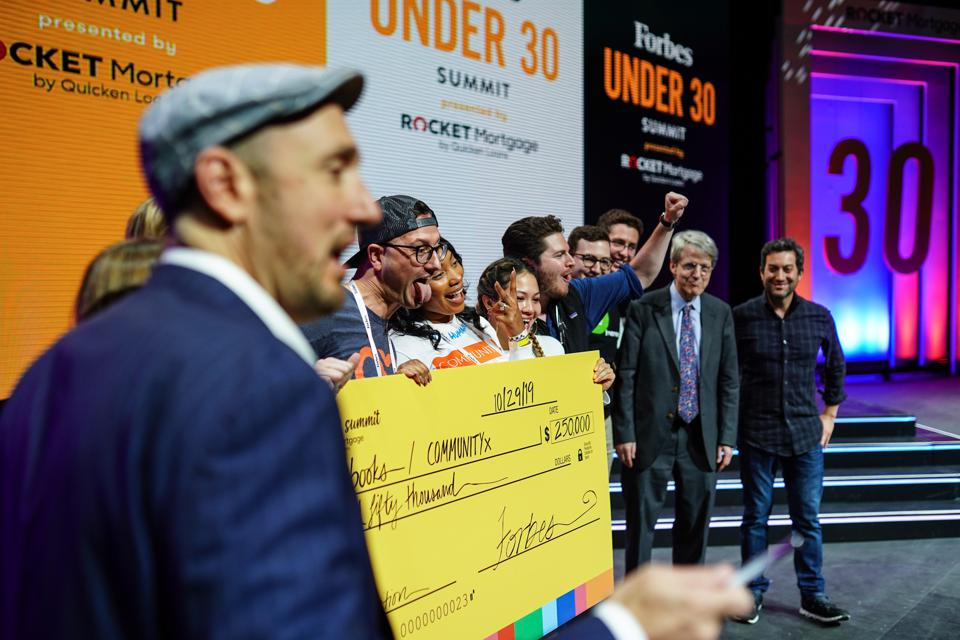 A $250,000 check was awarded to Autobooks and CommunityX in the Startup Pitch Competition.