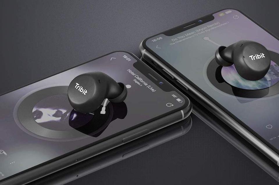 Tribit FlyBuds on smartphones.