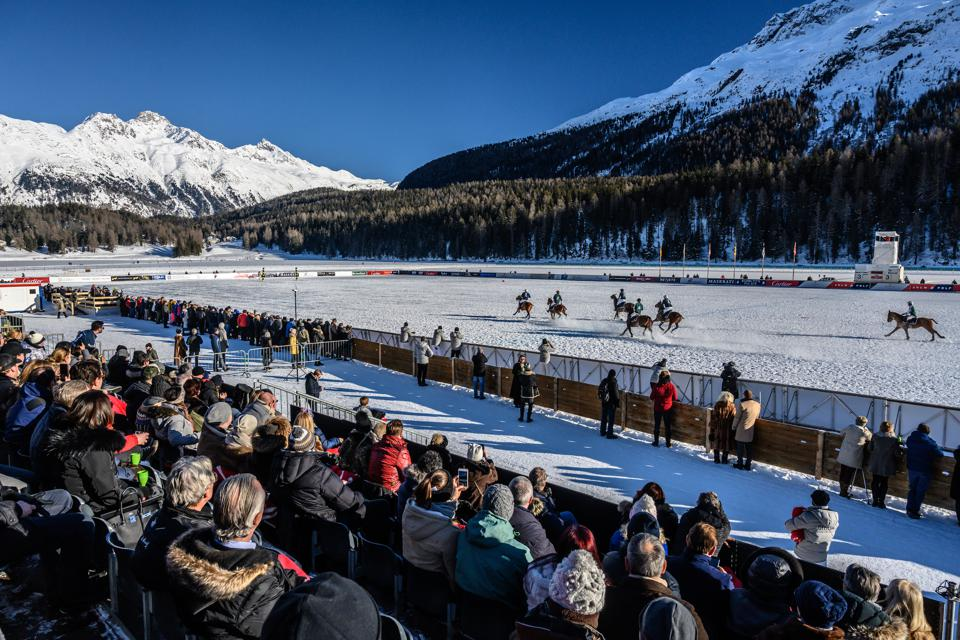 A fast-paced sport played on a snow-covered surface snow polo offers a glamorous venue with spectators sipping whisky and champagne as they watch from the stands. Snow Polo World Cup 2019 in St. Moritz is seen here.