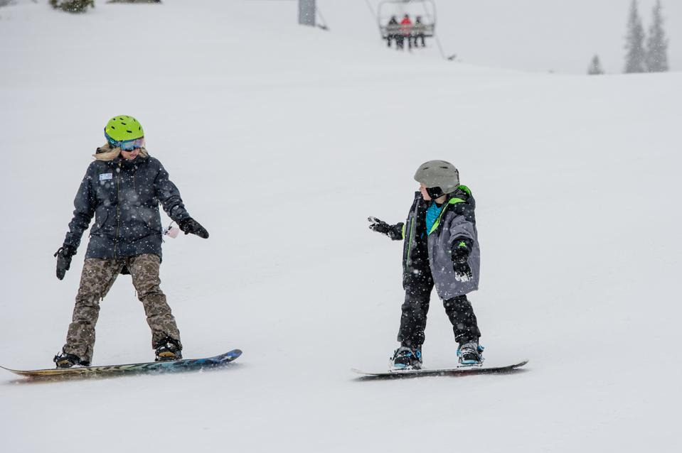 Constance Beverley, CEO of Share Winter, teaching snowboarding with the YMCA of Northern Utah.