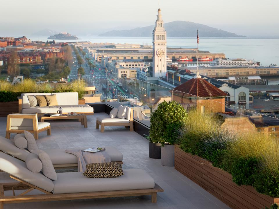 Outdoor amenity spaces offer panoramic views of Treasure Island and the iconic Ferry Building.