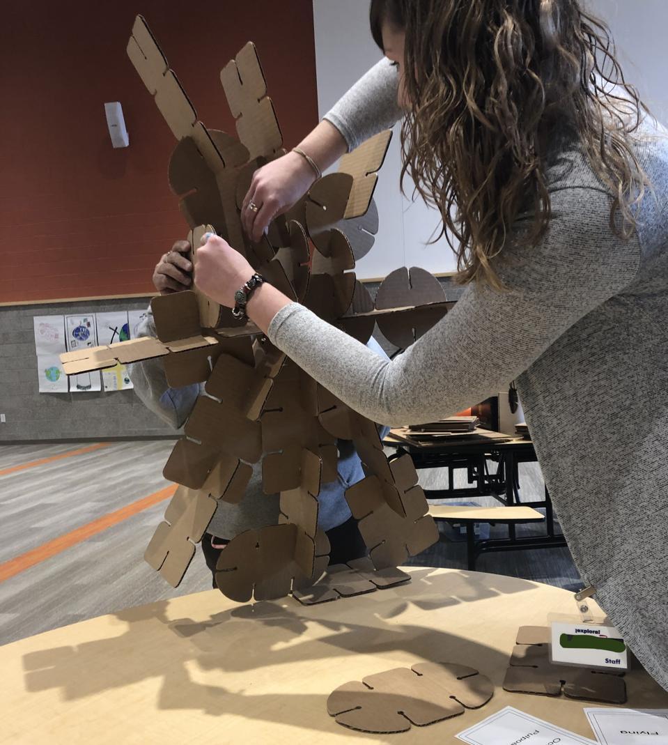 Explora student mid-construction