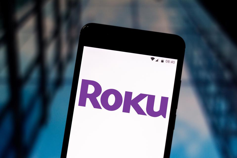 In this photo illustration the Roku logo is seen displayed...