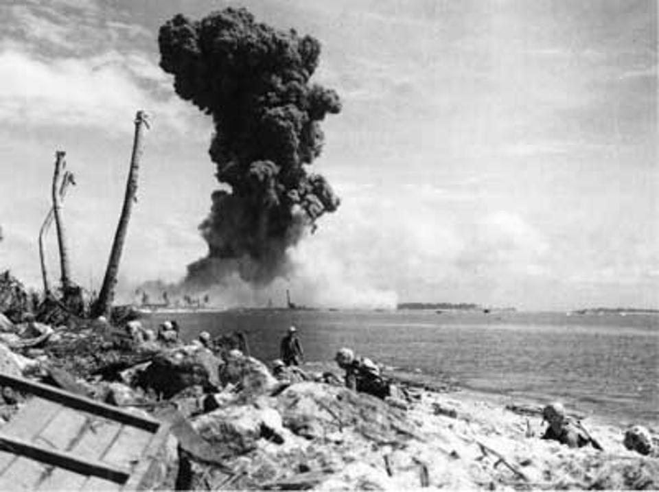 Marines on Roi island stare in astonihsment as a huge explosion consumes nearby Namur Isle