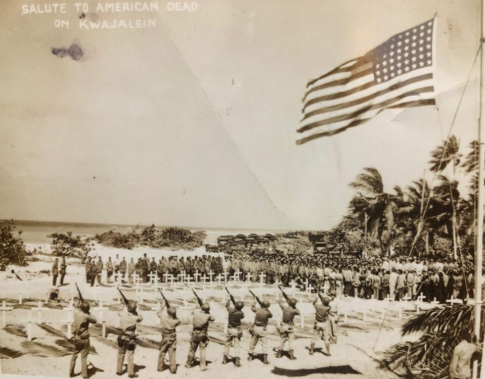 U.S. troops fire a salute before a grave for U.S. soldiers at Kwajalein.
