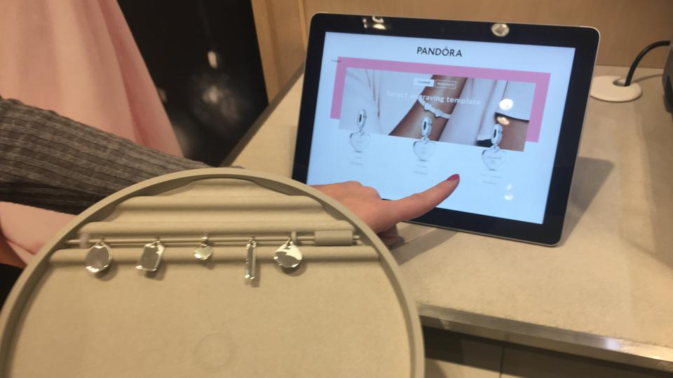 A demonstration of the engraving station at the new concept Pandora store in Paramus, N.J.