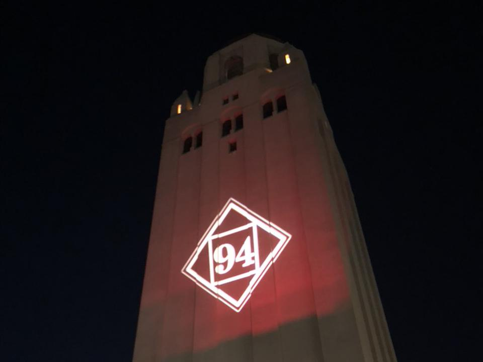 Hoover Tower with a large 94 projected on the side.