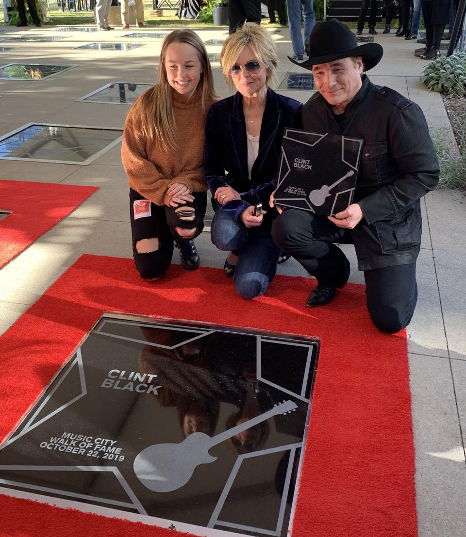 Clint Black being inducted into the Music City Walk of Fame (Pictured with daughter, Lily, and wife, Lisa Hartman Black)