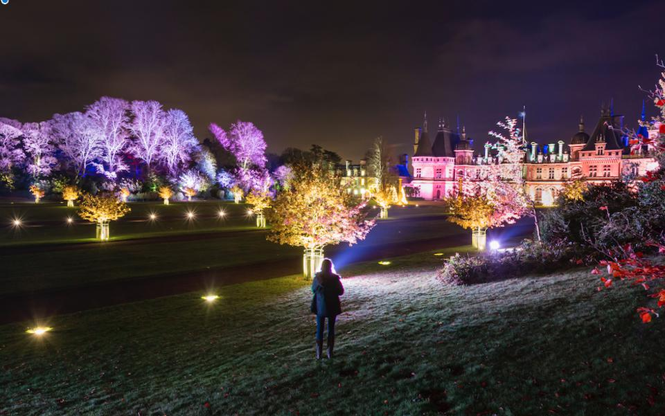 The estate illuminated at night.