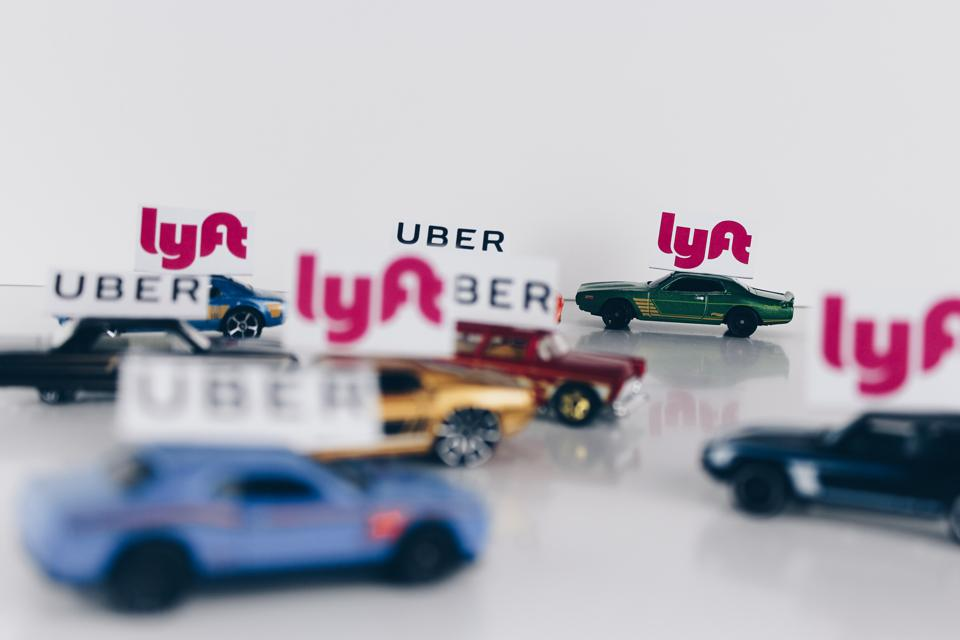 Toy cars labeled UBER and LYFT