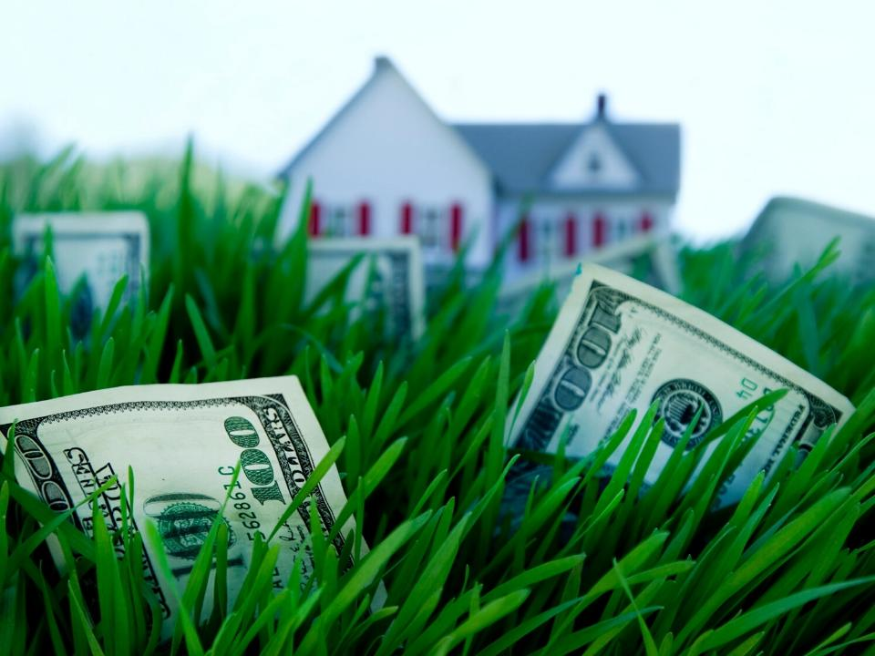 cash in the front lawn of a house