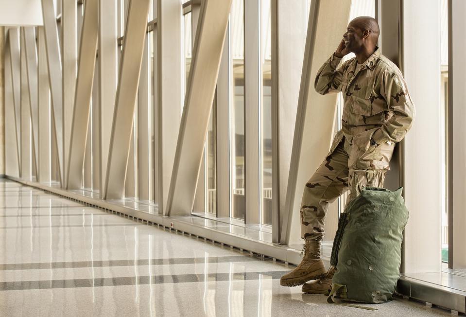 military man on phone