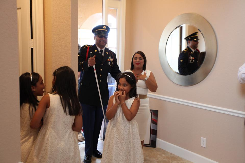 Blind veteran and family in donated home