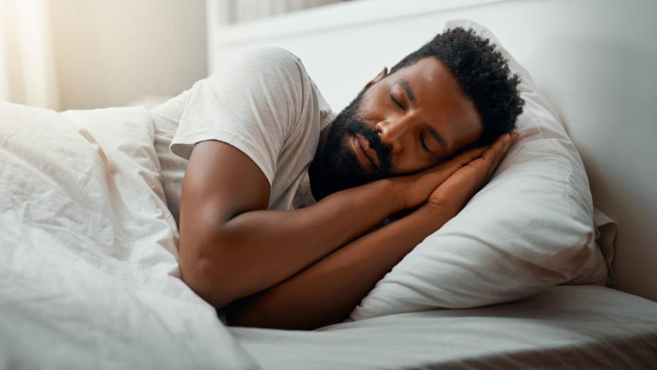 A man sleeping soundly in a hotel.