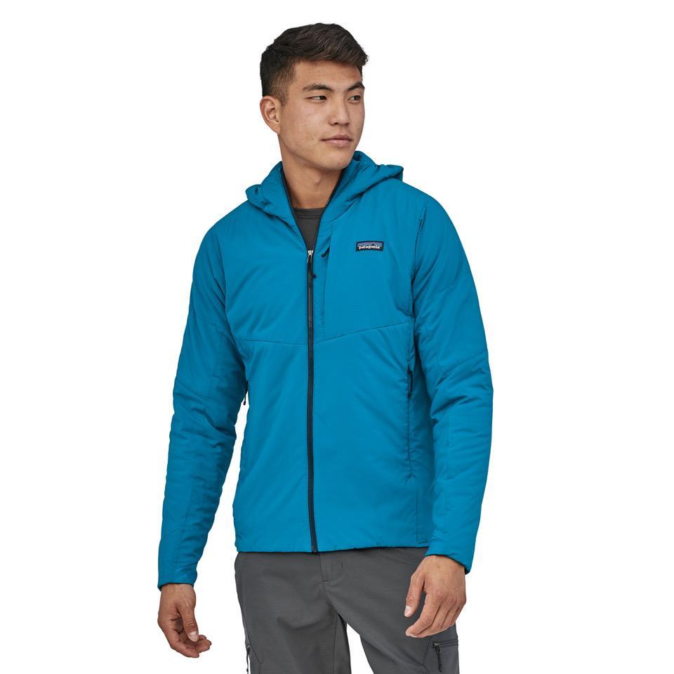 A man wearing the men's Patagonia Nano Air Hoodie