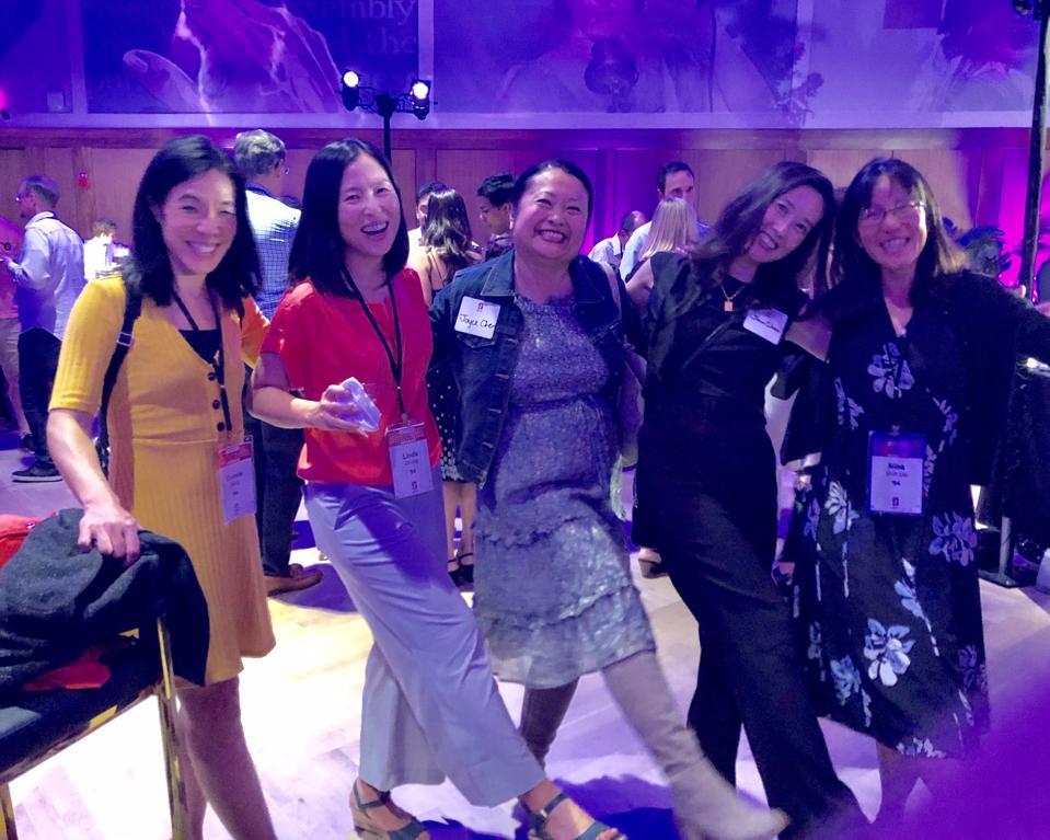 A group of women dances.
