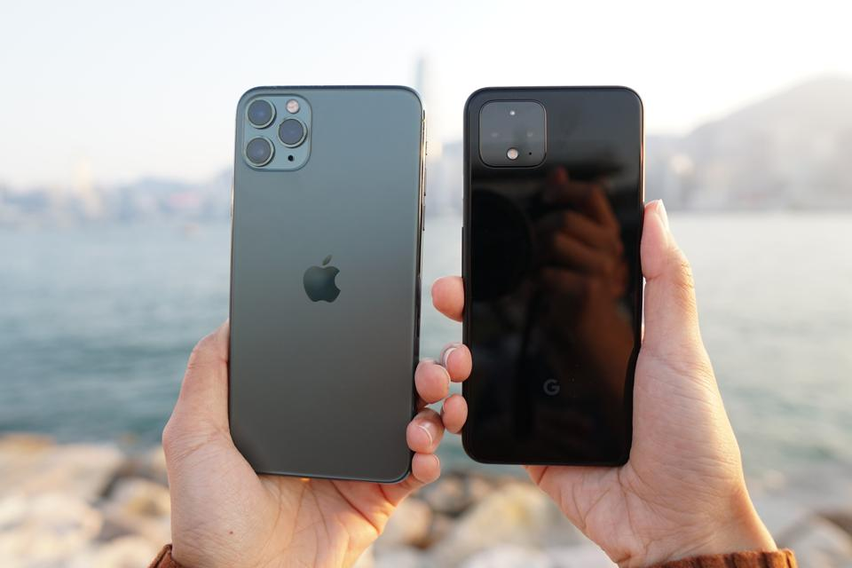 The camera modules of the iPhone 11 Pro Max and the Google Pixel 4.