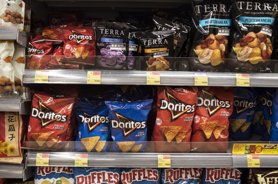Doritos American tortilla chips snack are displayed for sale...