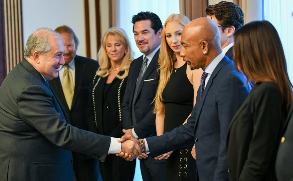 The President of Armenia, Armen Sarkissian, shaking the hand of Montel Williams at The Impact Humanity Television and Film Festival