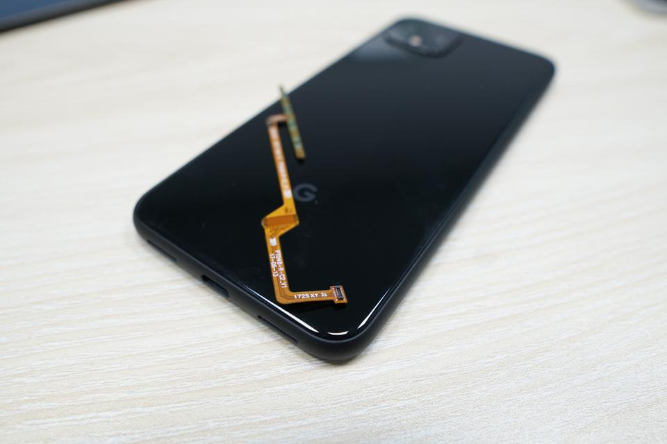 "The thin, flexible strip of ""force sensor"" that allows the Pixel 4 to feel a user's squeeze."