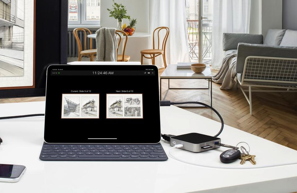 The USB-C travel dock plugs into one of a laptop's (usually) two USB-C ports