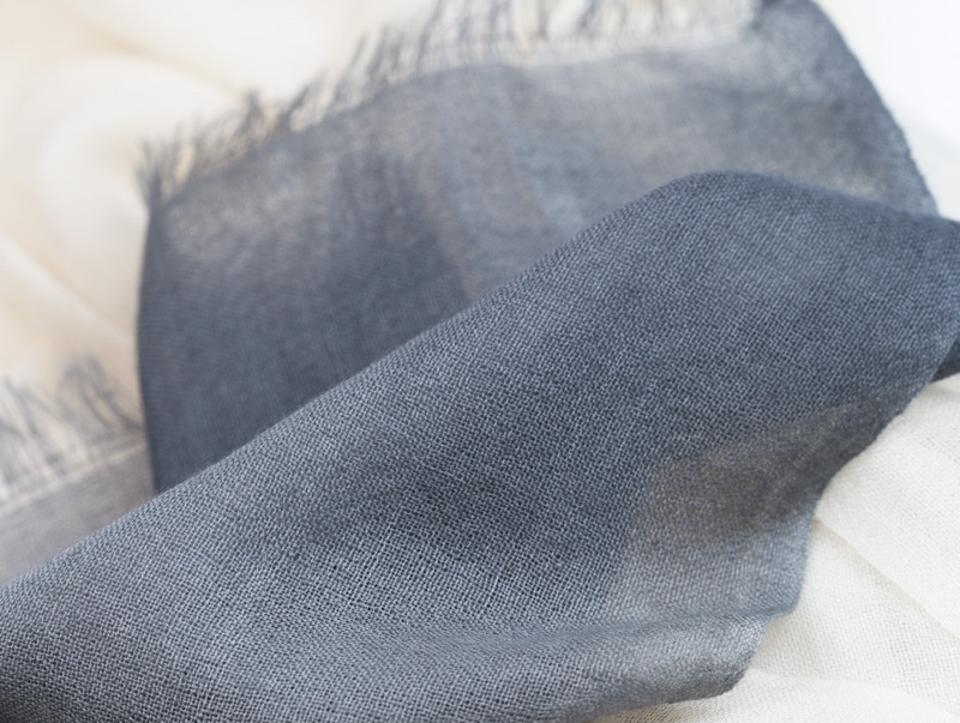 The feather-light ombre scarf brings style and warmth without weight, and has ethical values.