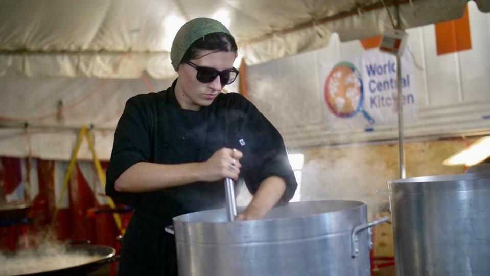 World Central Kitchen cook, Mckenzie Richerson, cooking in Marsh Harbor in the Bahamas