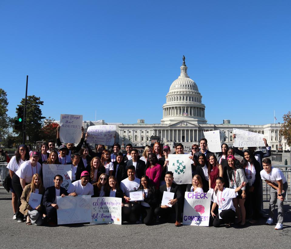 Members of the Youth Movement Against Alzheimer's disease deliver their message in the nation's capital.