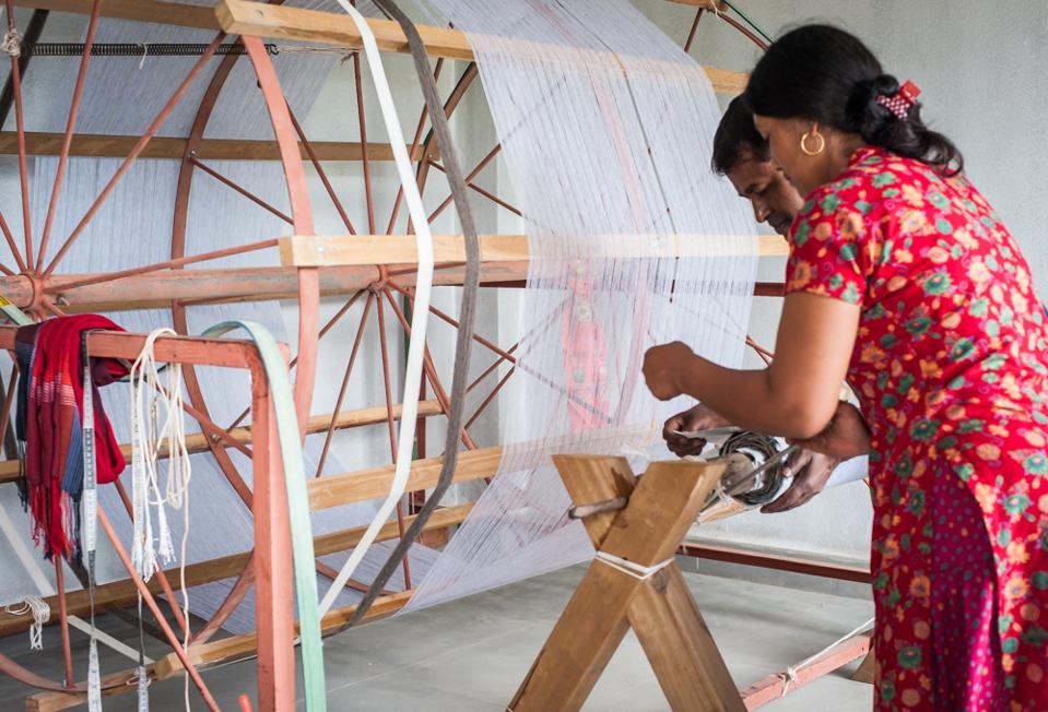 A woman preparing the warp for Thread Tales in Nepal.