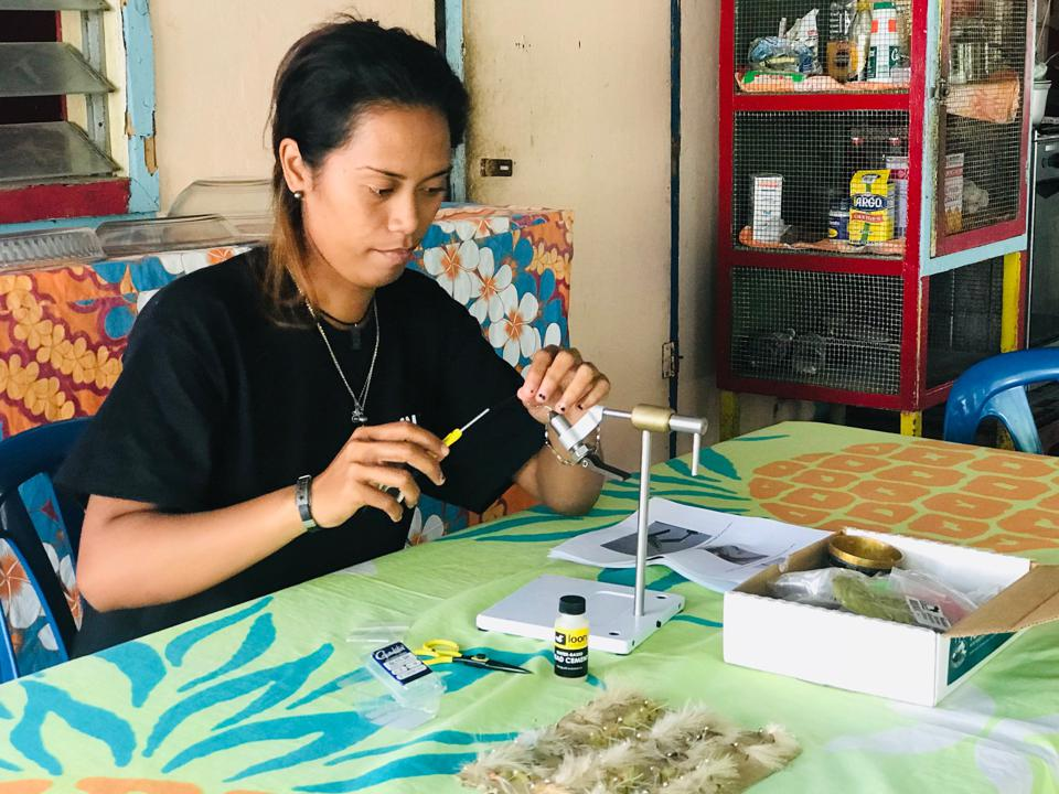 Locals make flies for fly fishing