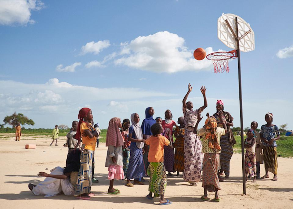 Girls play basketball at a displaced persons site in Ngagam, Niger. Recreational activities are set up by COOPI, an implementing partner of UNICEF, to create a sense of normalcy for children who have fled conflict.