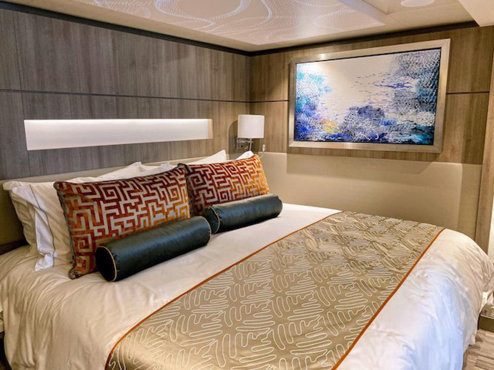 Comfy pillow-top bed in a Haven stateroom