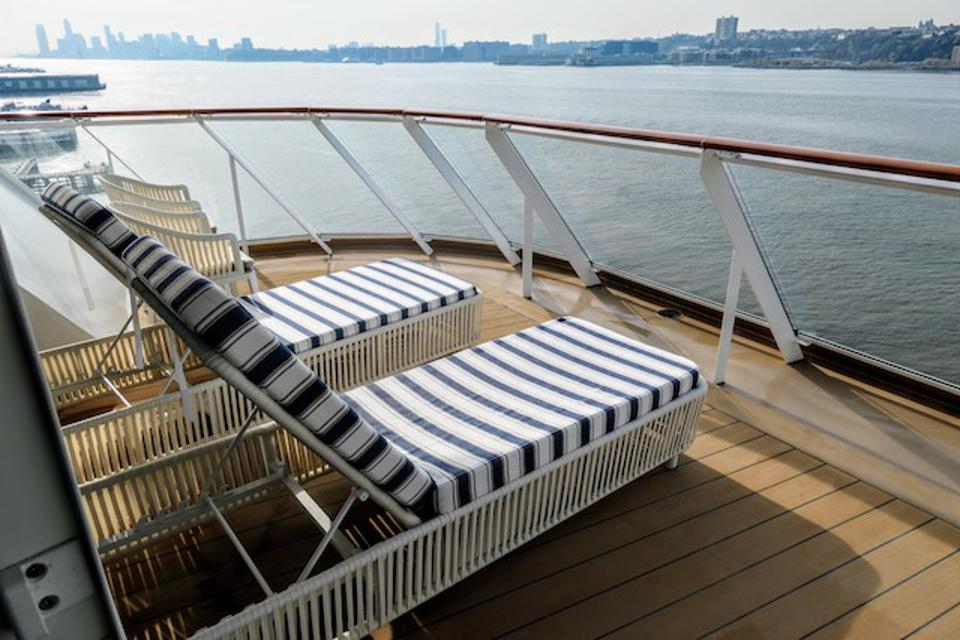 Balcony view on an aft-facing Penthouse Suite in the Haven on Norwegian Encore