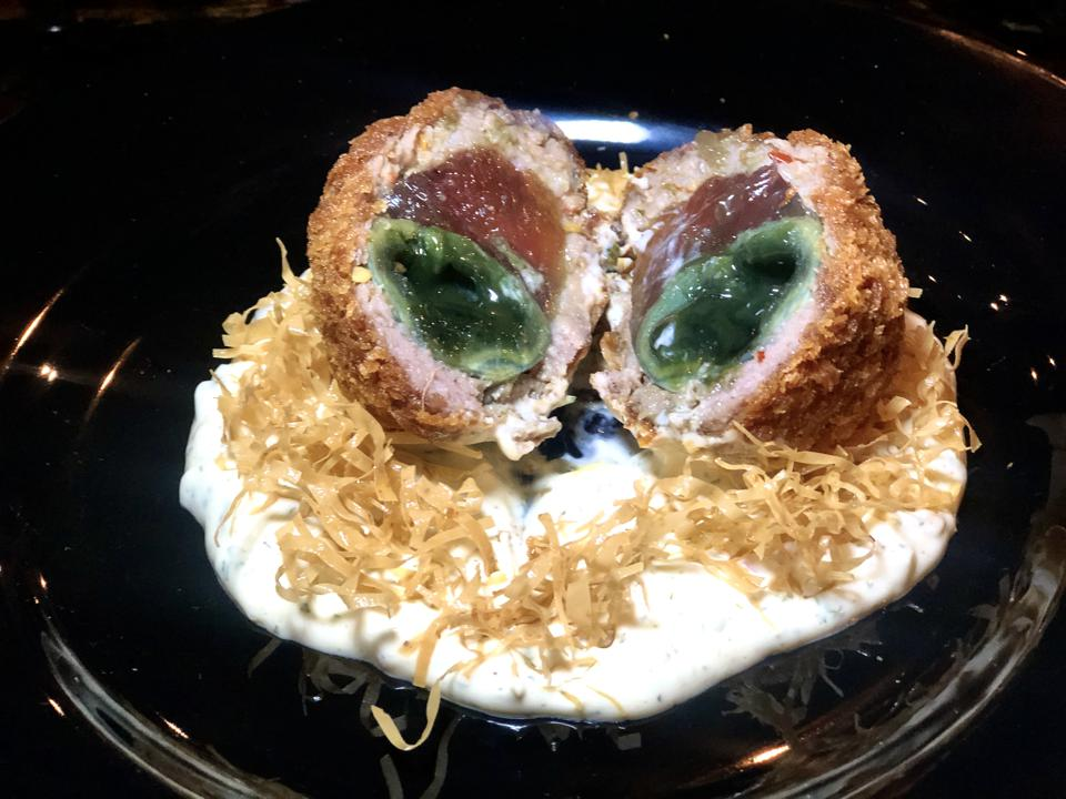 ″Birdʻs Nest″ Scotch Egg with tartar sauce and century egg at XO restaurant in Honolulu