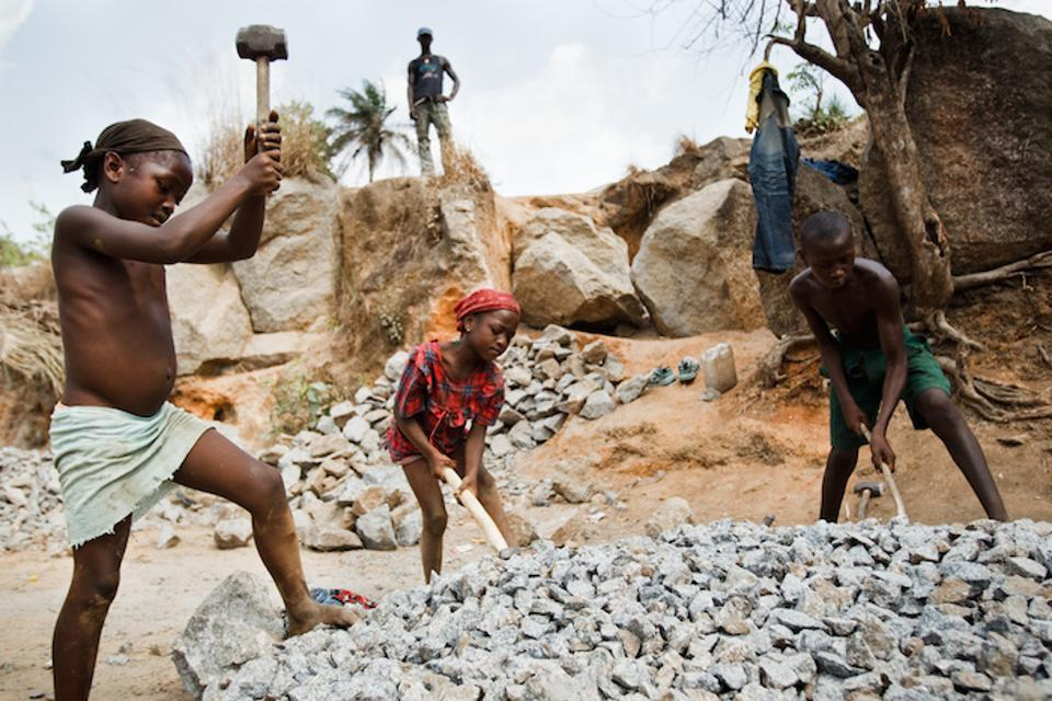 Child laborers toil at a rock quarry near the town of Makeni, Bombali District, Sierra Leone.