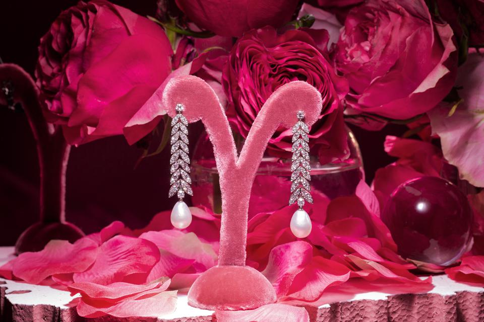 Graceful diamond and baroque pearl earrings by Margaret Jewels glow with gems of earth and sea.