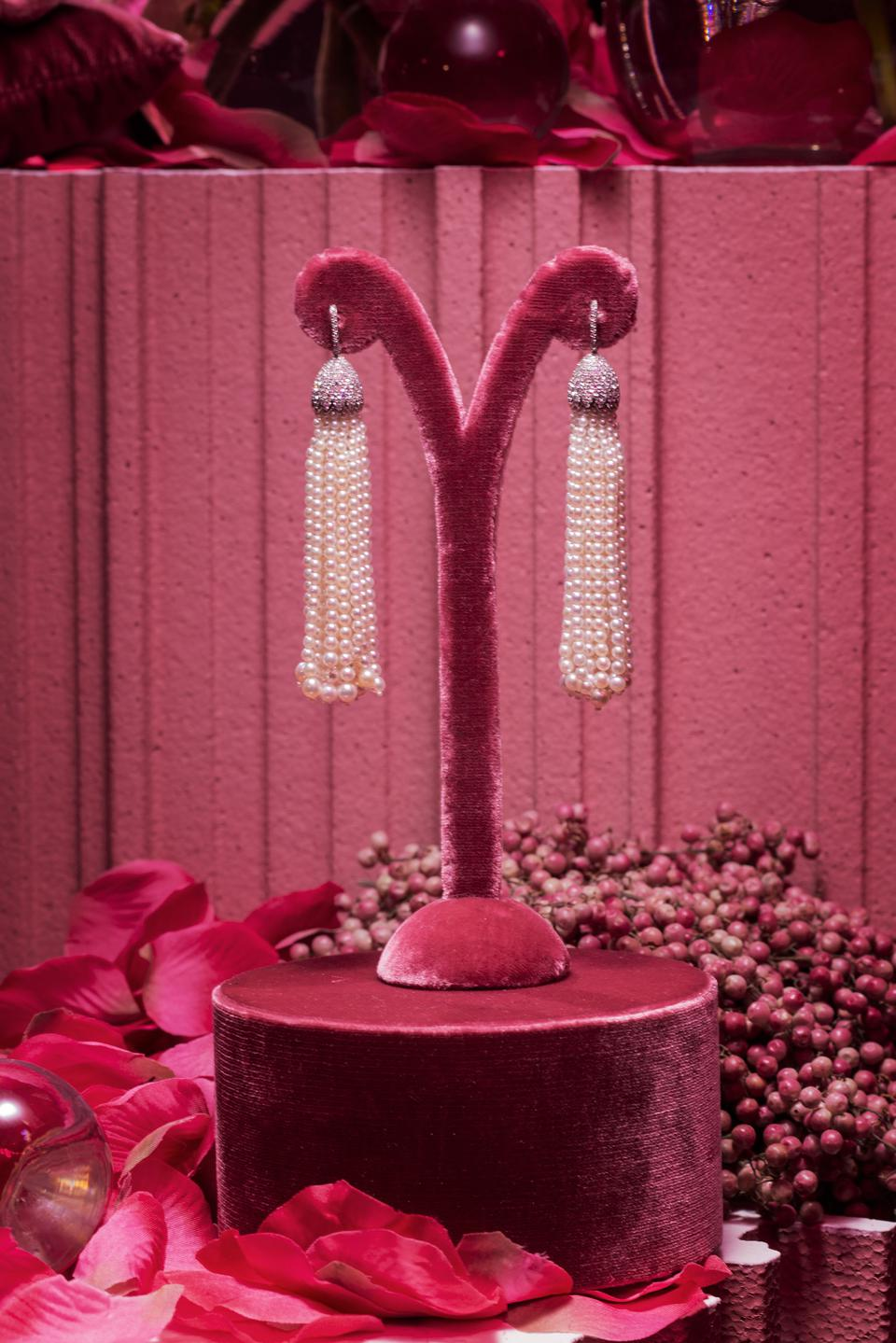 Diamond dome and pearl tassel earrings by Geneva-based Margaret Jewels exude luxury style