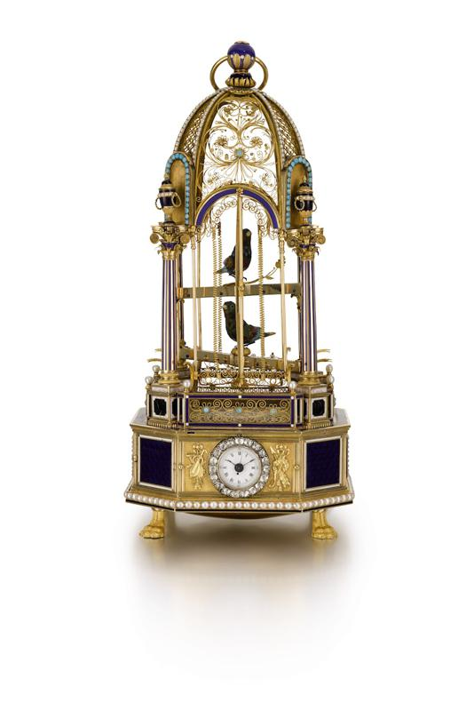 A gold, enamel and diamond-set hour striking musical double singing bird cage with timepiece made by Frères Rochat for the Chinese market, sold for $1,013,878.