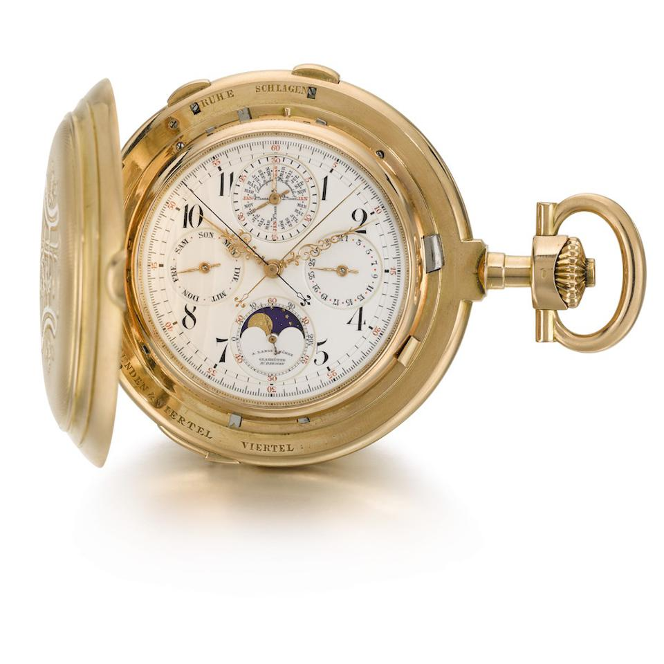 A pink gold hunting cased clock watch with perpetual calendar, minute repeater, moon phases and split seconds chronograph, circa 1901 by A. Lange & Söhne which sold for $439,180.