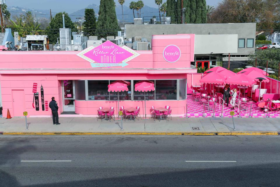 A pink diner with Benefit cosmetics signage.