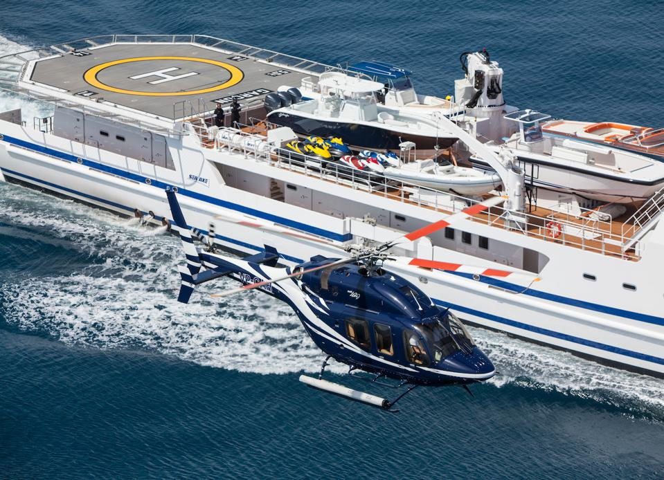 A Bell 429 helicopter takes off from a Damen Yacht Support Vessel
