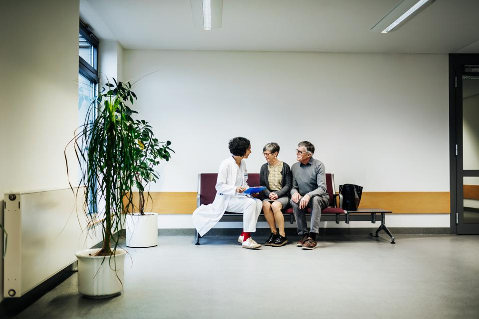 Doctor Talking To Elderly Couple