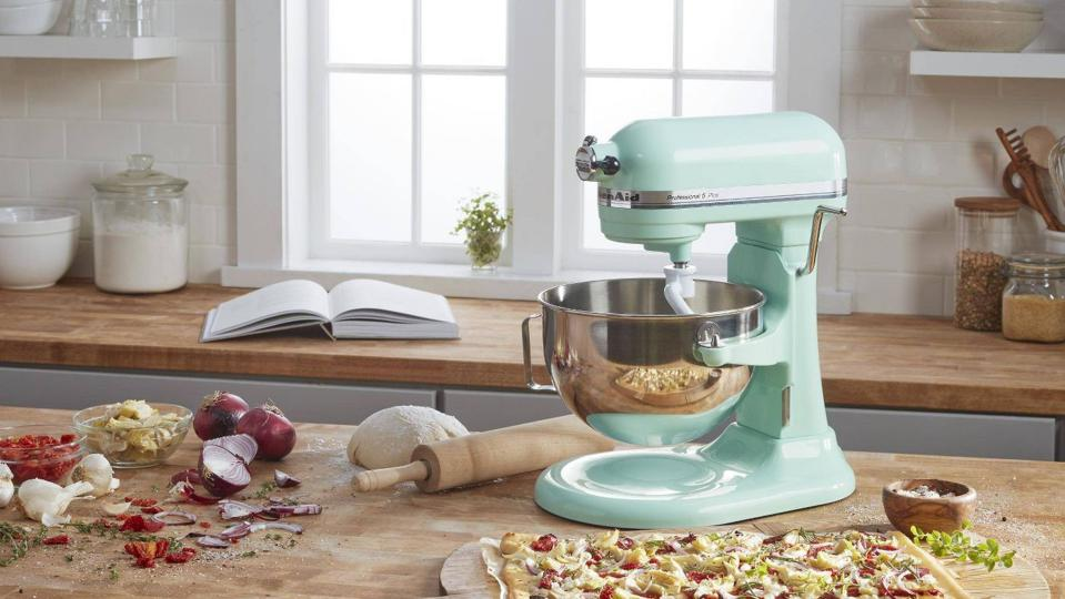 Green KitchenAid Professional Mixer in a kitchen.