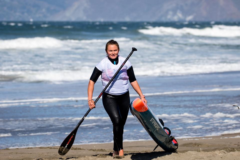 Fiona Wylde walks up shore