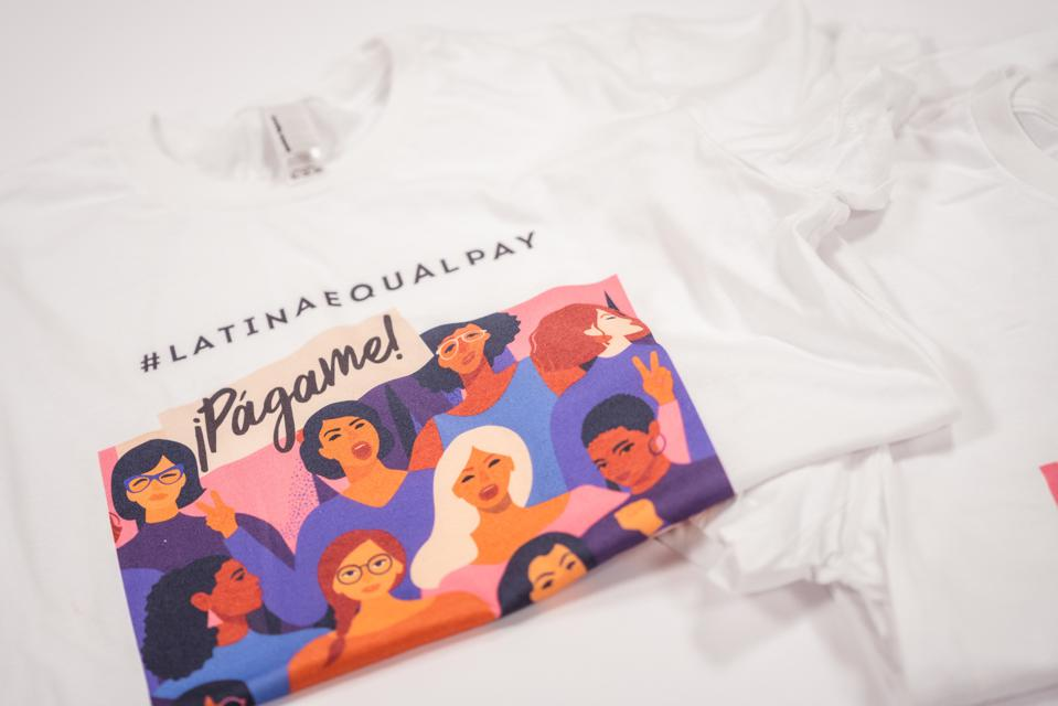 Pagame t-shirts, a part of #WeAllGrow's Latina Equal Pay Day campaign.