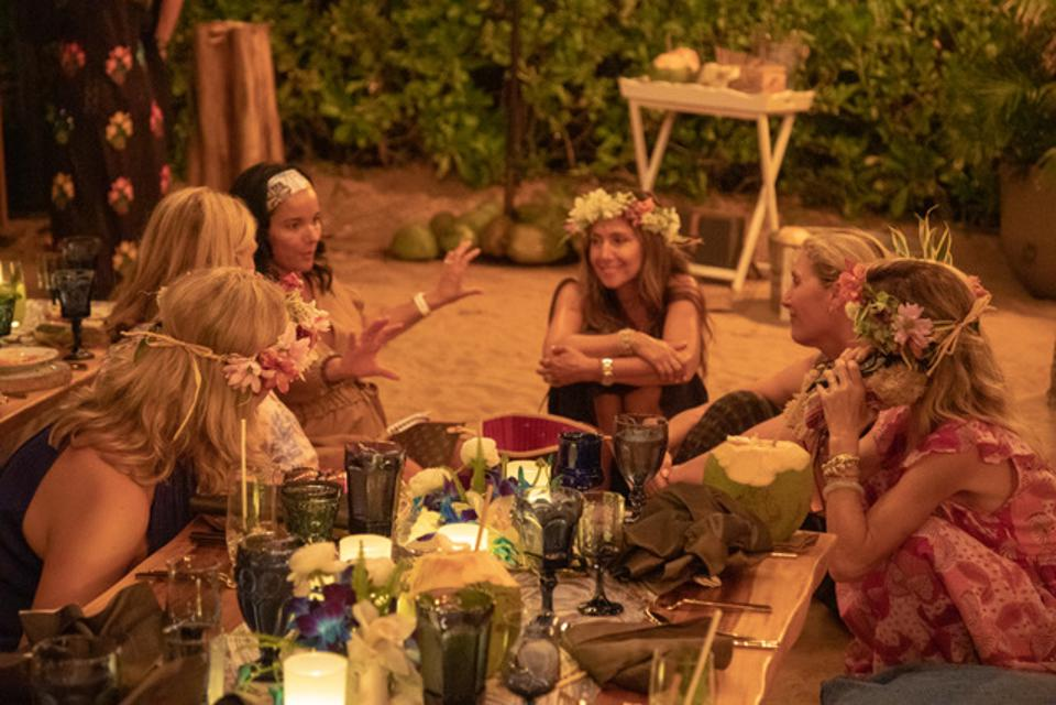 Attendees of Shift Wellness bonding over dinner at The Four Seasons Maui.