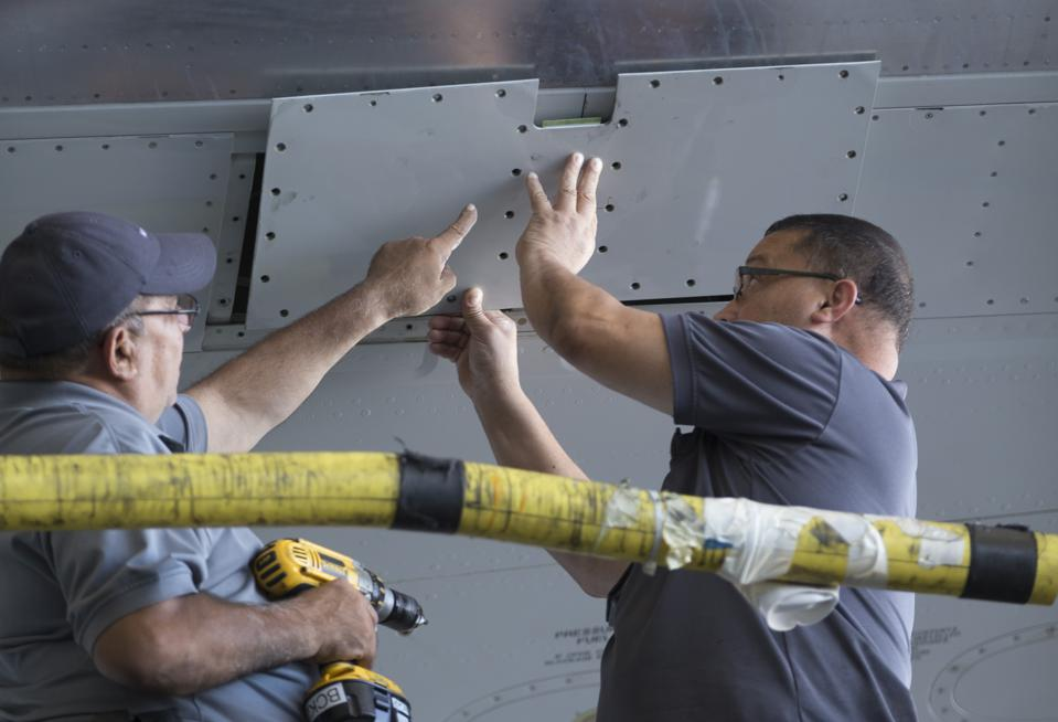 American Airlines mechanics work on an aircraft.