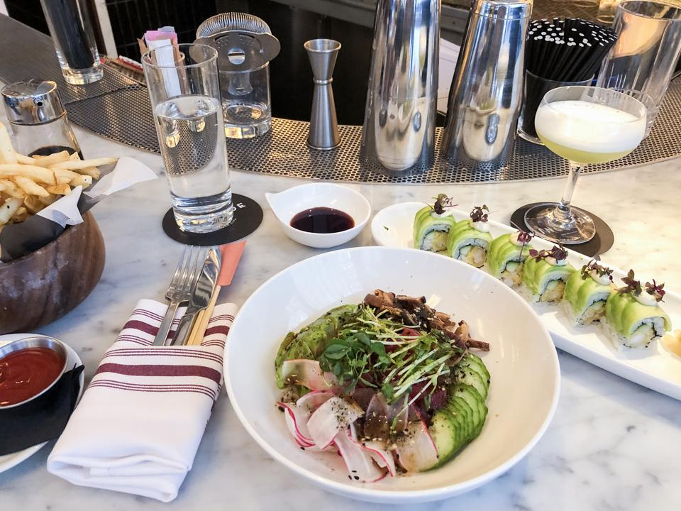 NEW YORK, NY - Lunch at Kingside at the Le Méridien Central Park, from left: salt & pepper fries, poke bowl and the shrimp tempura roll.