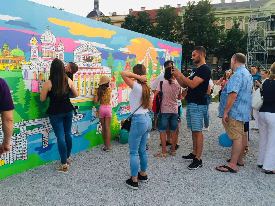 Artist Max Goshko-Dankov's coloring walls are raised in cities like Miami and Moscow (pictured here).