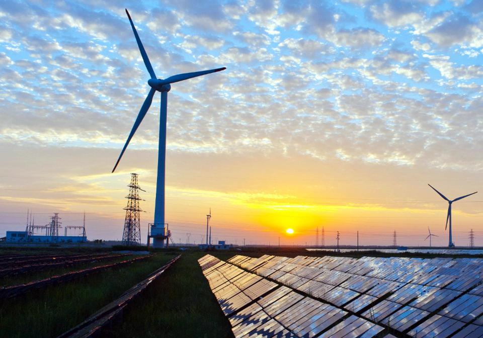 Solar panels, wind turbines, and electricity transmission lines